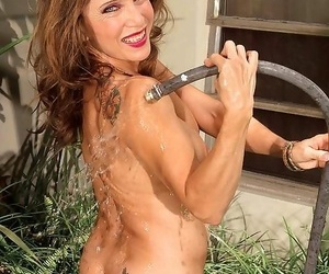 Super granny taking cold shower outdoor - part 4779