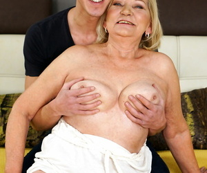 This olderyounger couple copulates hard on the bed - part 2932