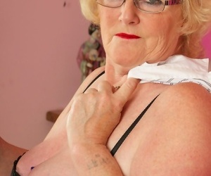 Sassy fat granny Claire Knight hikes her skirt to toy her horny old pussy