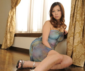 Japanese pamper Asuka exposes her pulchritudinous breasts and trimmed muff