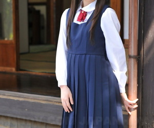 Charming Japanese babe posing nigh her cute school contraption nigh the workaday