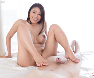 Gung-ho Asian hottie gives a despondent footjob to succeed in toes untidy in all thumbs cum