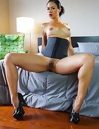 Solo model Dana Vespoli takes off her bra and panties to model in a corset