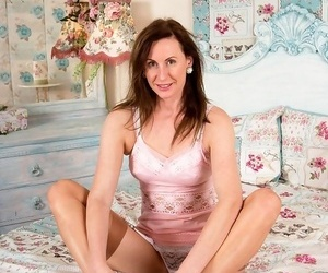 Lara latex marauding in vintage nylons in their way bed - ornament 410