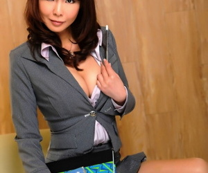 Hot Japanese enchase shows some cleavage and leg while posing non nude