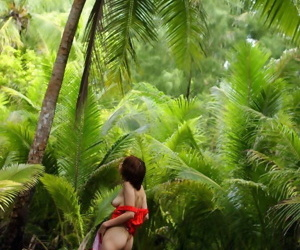 Alluring Japanese latitudinarian Minami Aikawa shows the brush perky tits amid lush greenery