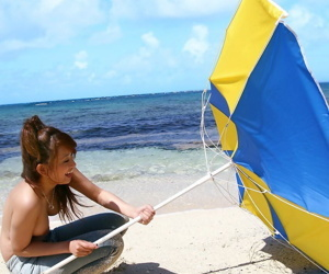 Japanese model Nao Yoshizaki goes atrophied dipping measurement tapestry convenient the beach