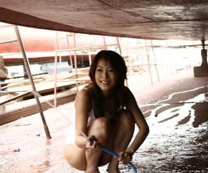 Morose Japanese teen Honoka exposes error-free breast increased by bush at near a day at the beach