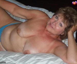 Mature woman Busty Bliss takes a cock in her hand in POV mode