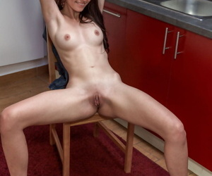Small dark hair Vanessa A peels off inflexible jeans for kitchen wet crack closeup