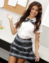 Long-haired Latina babe Ava Mendes strips and masturbates at school