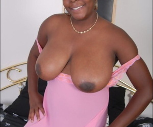 Black BBW releases large natural tits as she removes pink lingerie
