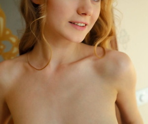 Slender pretty Nancy A disrobes from her lace lingerie to pose erotically nude
