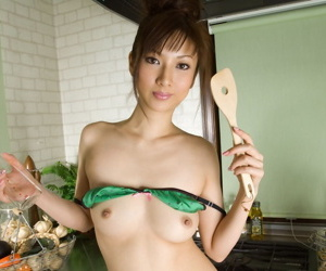 Young Japanese wholesale Reika poses unshod while trying on clothes plus lingerie