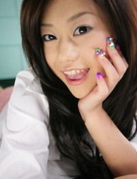 Cute Japanese teen Minako Oyama exposes her bra and panty set upon her bed