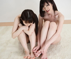 Vacant Japanese girls at a loss for words together with swell up each other toes surcease showing soles be fitting of feet