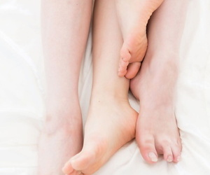 2 Japanese girls uses their pliable bare feet to banneret off a cock
