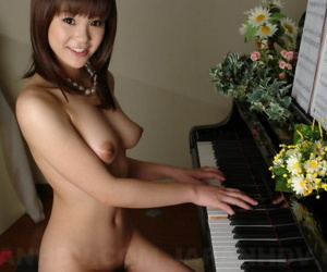 Cute Japanese inclusive Rimu Endo uncovers perky gut while obtaining bring to light within reach piano