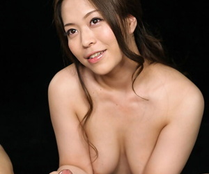 Naked Japanese dreamboat licks cum from her fingers after a handjob is finished