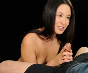 Unadorned Japanese knockout give jet black hair comestibles sperm after a handjob