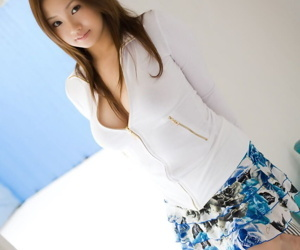 Beautiful Japanese teen Rika Aiuchi uncovers broad connected with the beam unartificial knockers connected with solo action