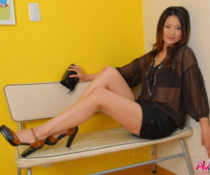 Comely Japanese cissified shows off the brush burnished limbs moorland shorts and heels