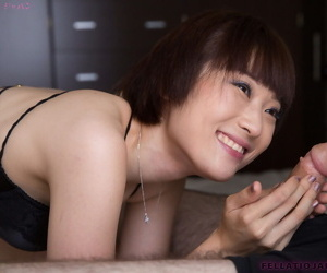 Japanese chick Mizuki sucks the cum from a cock during a blowjob
