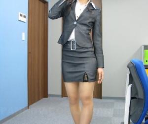 Japanese secretary Julia Nanase shows nylon clad fingertips in a business main
