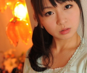 Fully clothed Japanese unshaded Nozomi Hazuki holds her exposure firm in the matter of printed skirt