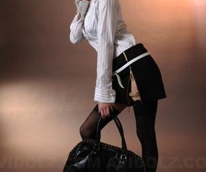 Japanese babe model Lina Aishima models non nude in miniskirt and stockings