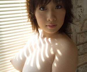 Japanese solo girl Hanano Nono fondles her humongous gut in be transferred to raw