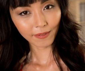 Pulchritudinous Asian Marica Hase erotically reveals small unpretentious tits & petite pussy