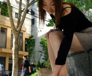 Young Japanese skirt Kumi removes skirt and heels nearby model naked in New Zealand pub room