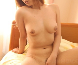 Japanese MILF Misaki Aiba reveals the brush pert tits before laying open the brush trimmed mess up