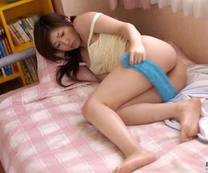 Japanese teen Mrano Matsushita slips pantihose yield her titillating bore with the addition of hairy bush