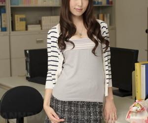 Japanese medical secretary Yui Hatano slowly strips at her workstation