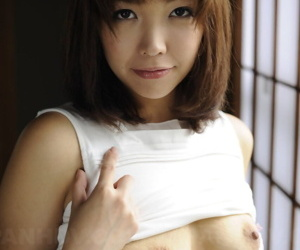 Japanese unparalleled girl Juri Kitahara tentatively shows her trimmed pussy