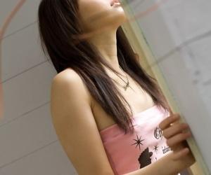 Bonny Japanese teen Misa Shinozaki crosses their way in the buff legs voucher disrobing