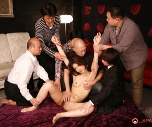 Petite Japanese redhead Julia Nanase endures breast groping undraped