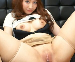 Japanese redhead Akari Niiyama showcases will not hear of shaved vagina upon sheer nylons