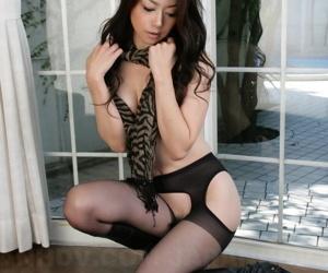 Hot Asian Sayuri Shiraishi poses topless in crotchless pantyhose & boots