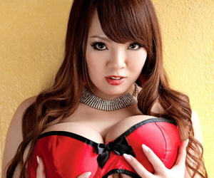 Beautiful Asian girl Hitomi plays with her massive knockers in nylons and heels