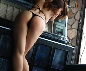 Asian bird Sumire Aida touts her accurate ass in bikini bottoms during solo action