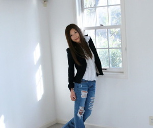 Young Japanese comprehensive Seira strikes heady poses around solo bit
