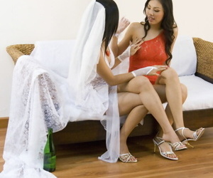 Asian bride is relieved of wedding attire by her lesbian lover