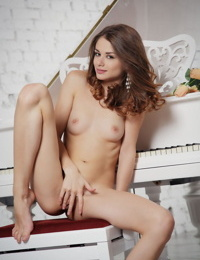 Skinny young Euro Loretta A poses naked to flaunt her shaved bald pussy