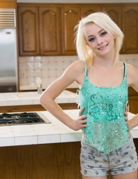 Petite blonde girl Maddy Rose finger spreads her pink pussy on kitchen counter