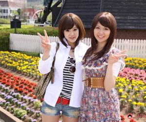 Japanese lesbians Rimu Endo & Ueno Misaki bill bare arms while drawing a stroll