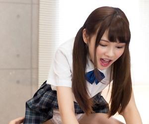 Japanese schoolgirl pulls down the brush panties vanguard sitting on a boys feature