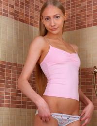 Slim teen Natalya takes off cute panties to get naked in the shower